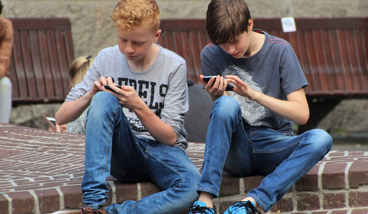 Kids using cell phones